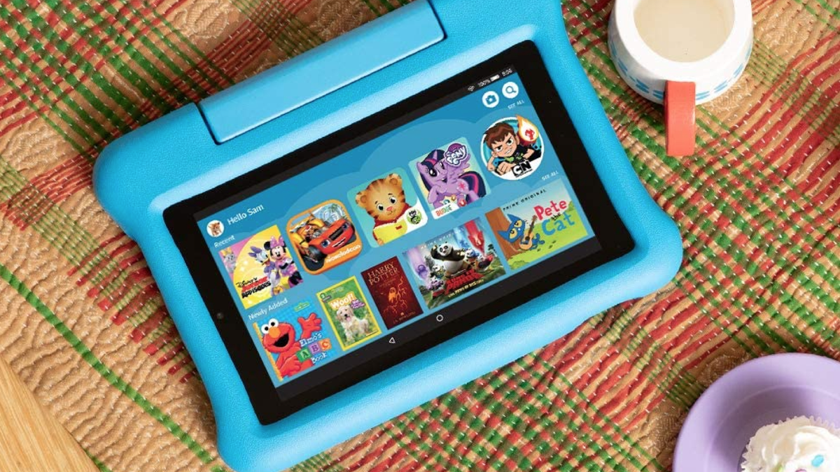 child's Amazon Fire 7 in a plastic case on a table beside play food