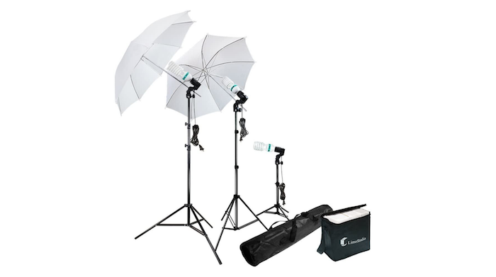 two white photo umbrellas with a smaller umbrella-less light and two black carrying cases