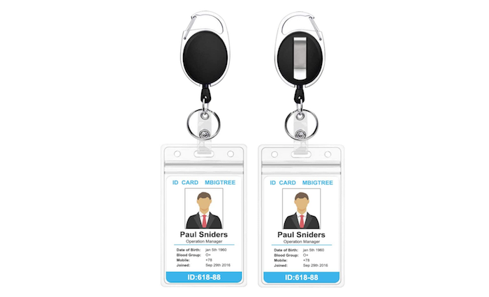 black oval badge reels with plastic sleeves and silvery hooks