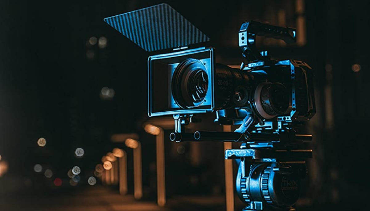 a camera with a matte box on it set up for filming in a dark area