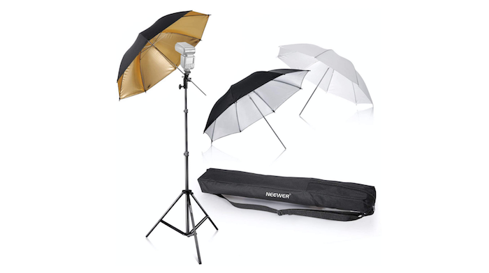 two black and one white photo umbrella with a black tripod and black carrying case