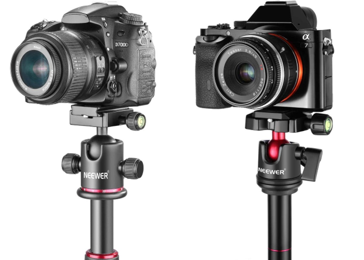 two different cameras mounted on two different tripod ball heads