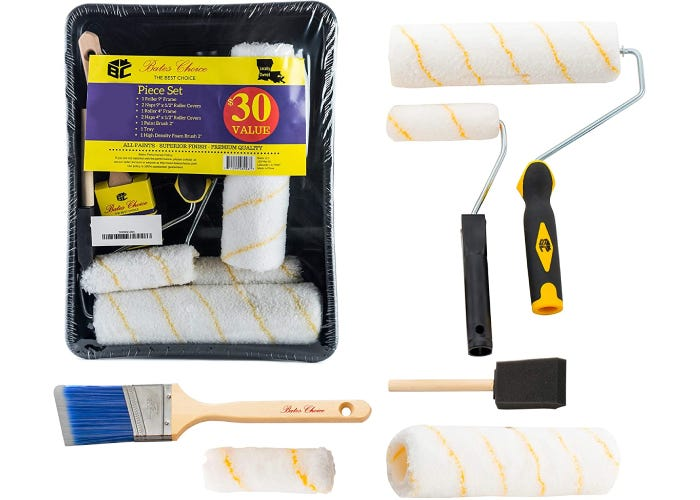 two different sized paint rollers with two other types of paintbrushes and a packet of spare roller heads