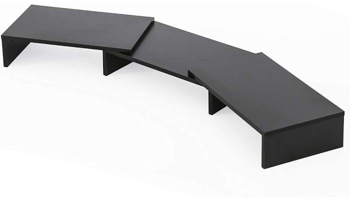 horizontal black desk-like monitor stand