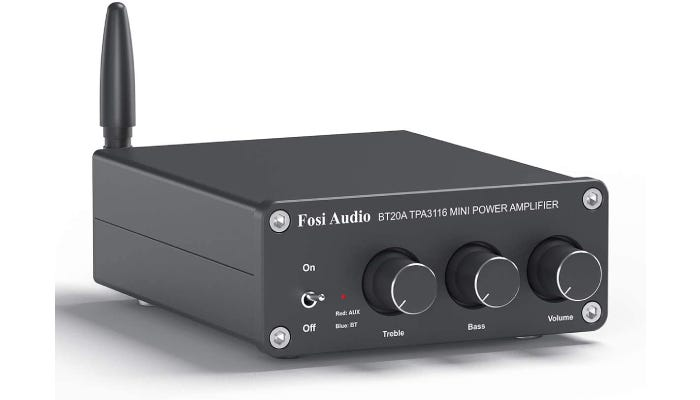 dark gray stereo receiver with elongated knobs and a short fat antenna
