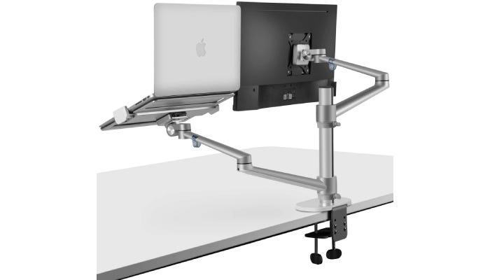 chrome dual monitor stand with two separate mounts supporting a monitor and a laptop