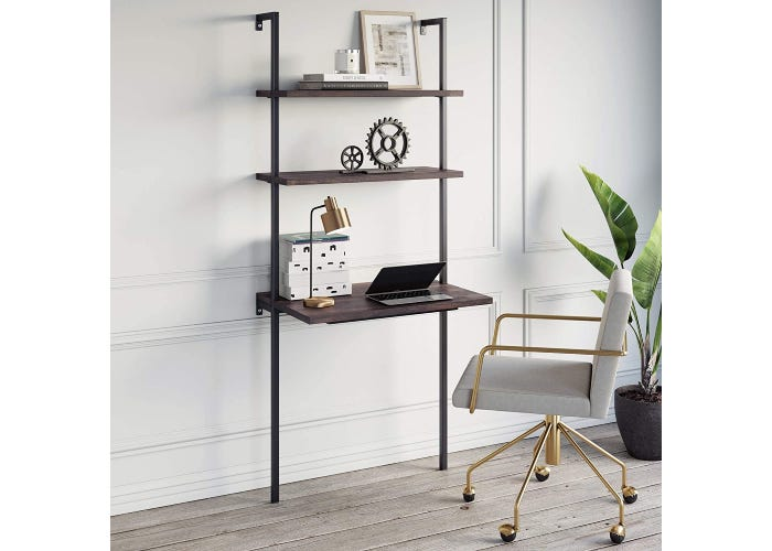 brown three-tiered wall desk with legs supporting a laptop and lamp and several decorations