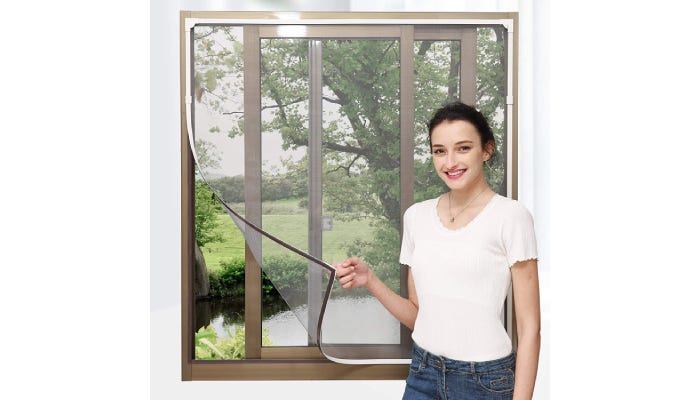woman peeling a screen away from the window