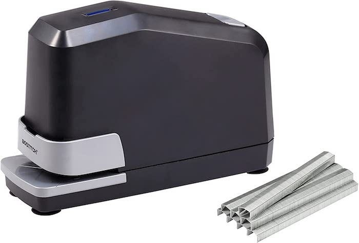 block-like black electric stapler with a stack of staples