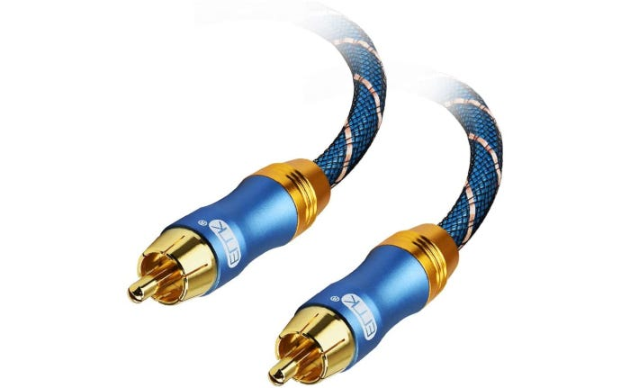 closeup of two blue and white rope-like subwoofer cables with brass-colored ends