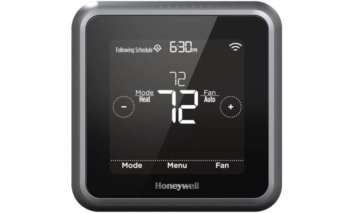 square black smart thermostat with a gray border