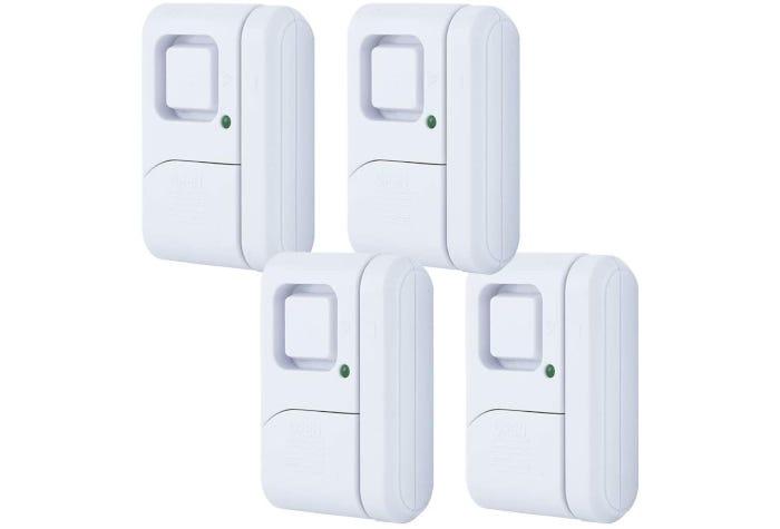 four white door security alarms