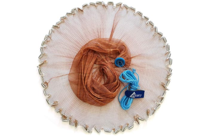 white and brown mesh fishing net with jagged edges and a sky blue cord