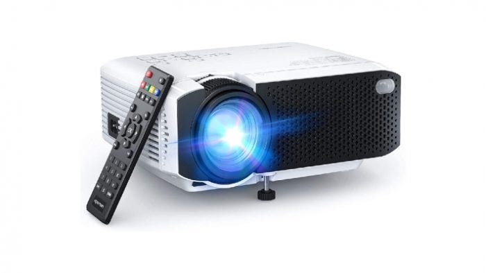 white and black mini screen projector with a black remote control