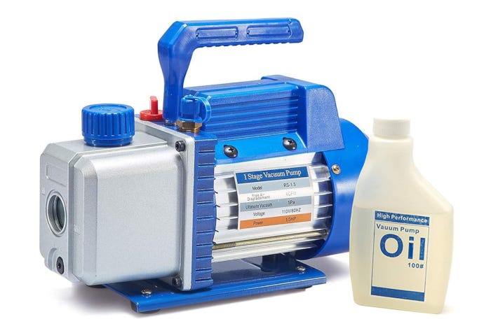 light gray and blue vacuum pump with a carrying handle and a bottle of oil