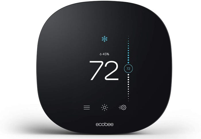 rounded black smart thermostat with white letters