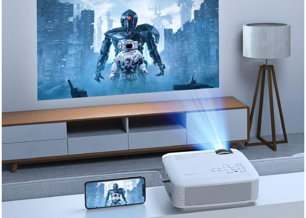 white projector showing an image of an astronaut and a robot on a tv in a modern living room