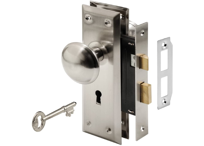 round chrome door handle on a vertical chrome mount with a key