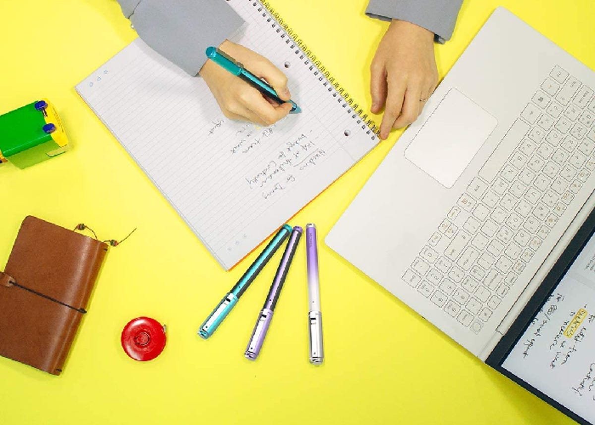 person using smart pen to take notes