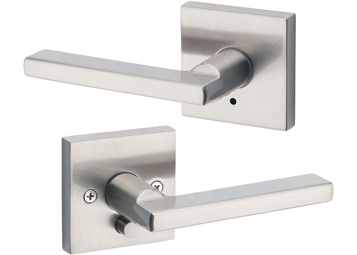 two blocked chrome door handles on square mounts