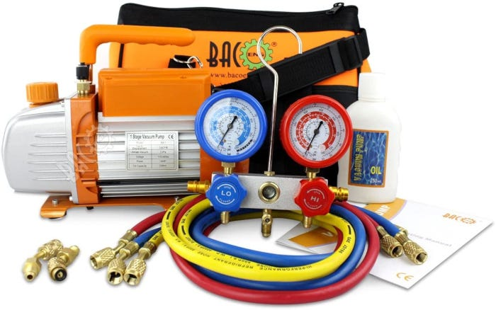 light gray and orange and black vacuum pump with various accessories