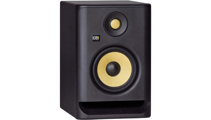 black studio monitor with yellow accents
