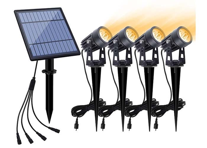 set of four swivel black solar landscape lights with a solar panel