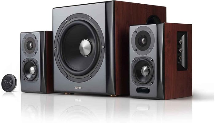 set of different sized black and red-brown studio monitors