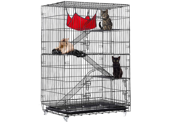 three cats inside a tall four-tiered cage-like cat kennel