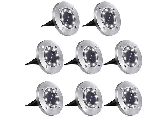 set of short, rounded, chrome solar landscape lights with black spiked bottoms