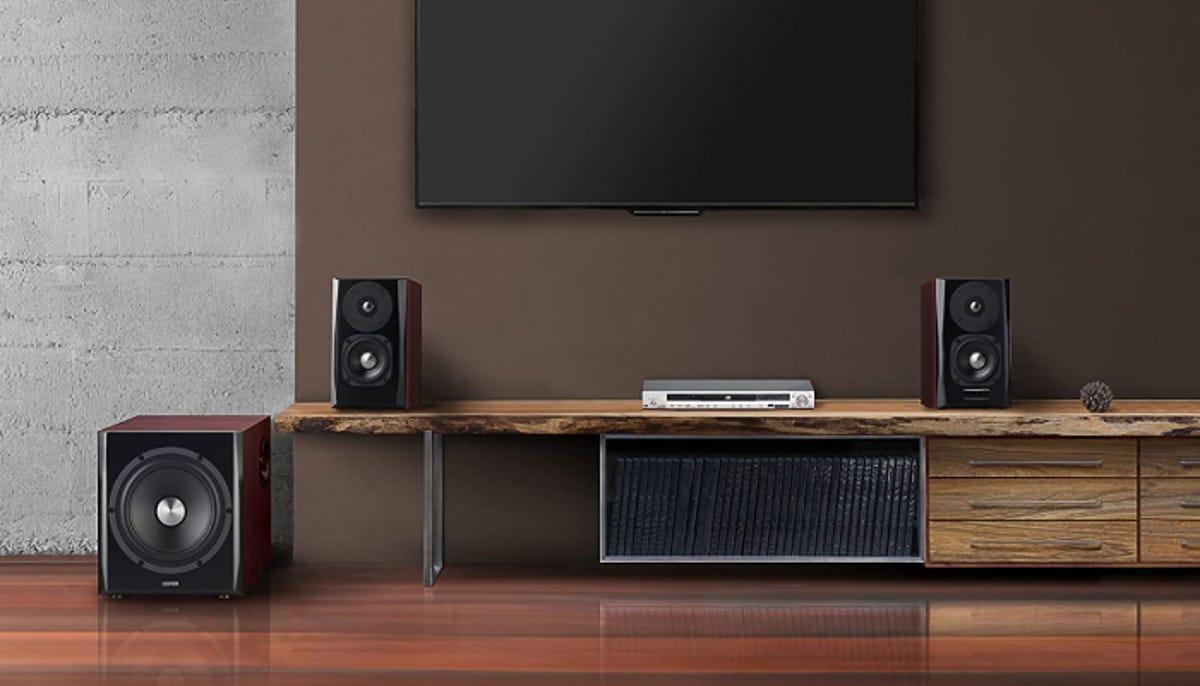 set of studio monitors with a flatscreen TV in a modern living room