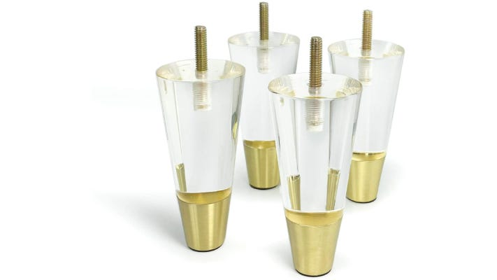 set of four tapered cylindrical clear and gold couch legs with built-in screws