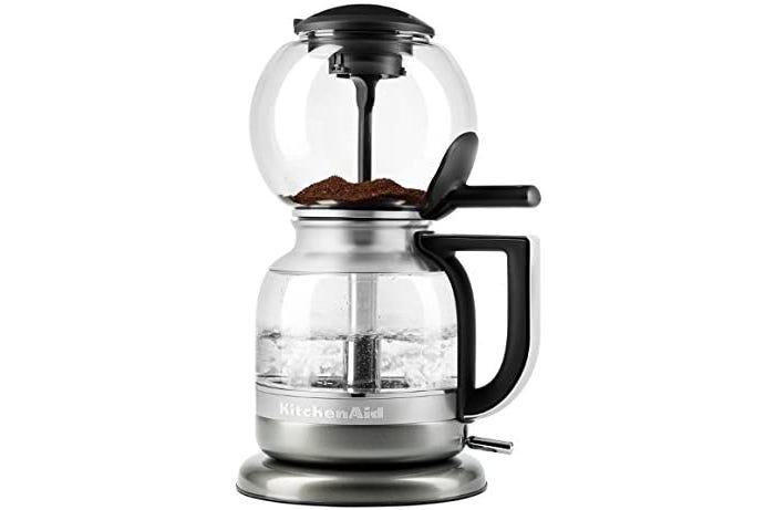 Electric siphon coffee maker with glass dome top coffee grounds compartment, traditional glass carafe, and stainless steel base