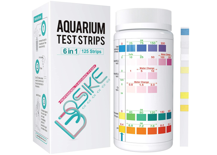 aquarium water testing strip with yellow, white, and blue markings next to its bottle and box