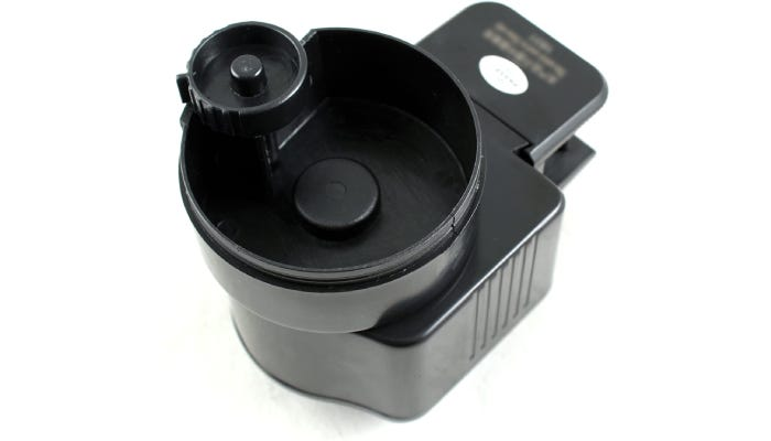 A drum style feeder that contains a switch on its backside to operate between a 12 or 24 hour feeding schedule.