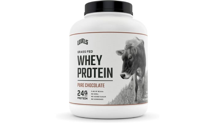 A large container of Levels why protein powder with a picture of a cow on it