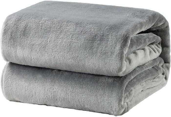 folded light gray fleece blanket