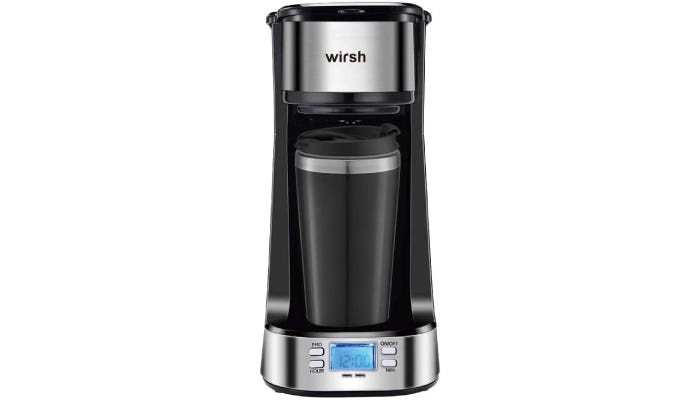 A slim and polished black and chrome coffee maker that features an LCD display with four button operation at the base of the device.
