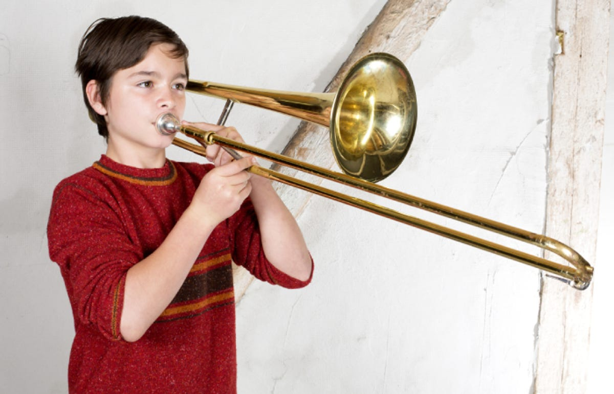 boy playing a brass trombone