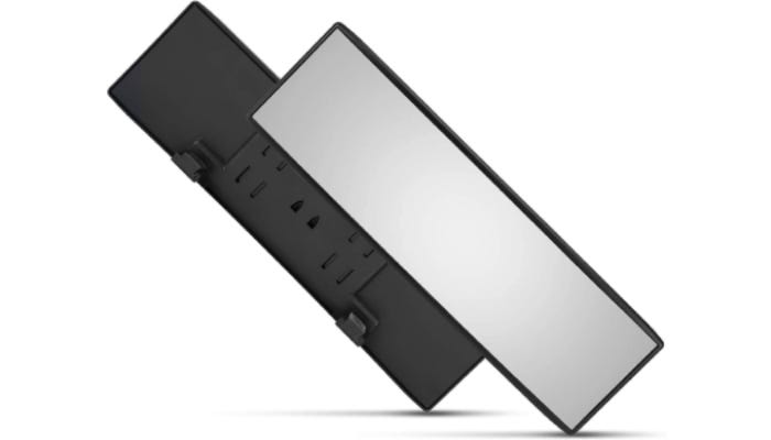 The front of a car rearview mirror is shown on top of the back of a car rearview mirror. Both mirrors are balancing on their right corners and each casts a small shadow.