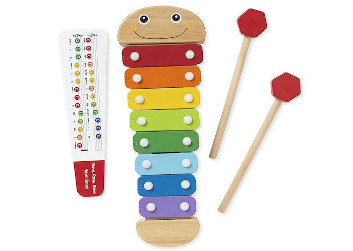toy xylophone with rainbow keys, two red-tipped mallets, and a music chart
