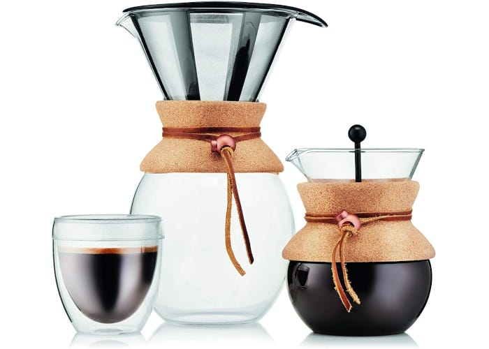 Glass pour-over coffee maker with a slightly rounded bottom and a permanent coffee filter attached to the mouth of the glass carafe.