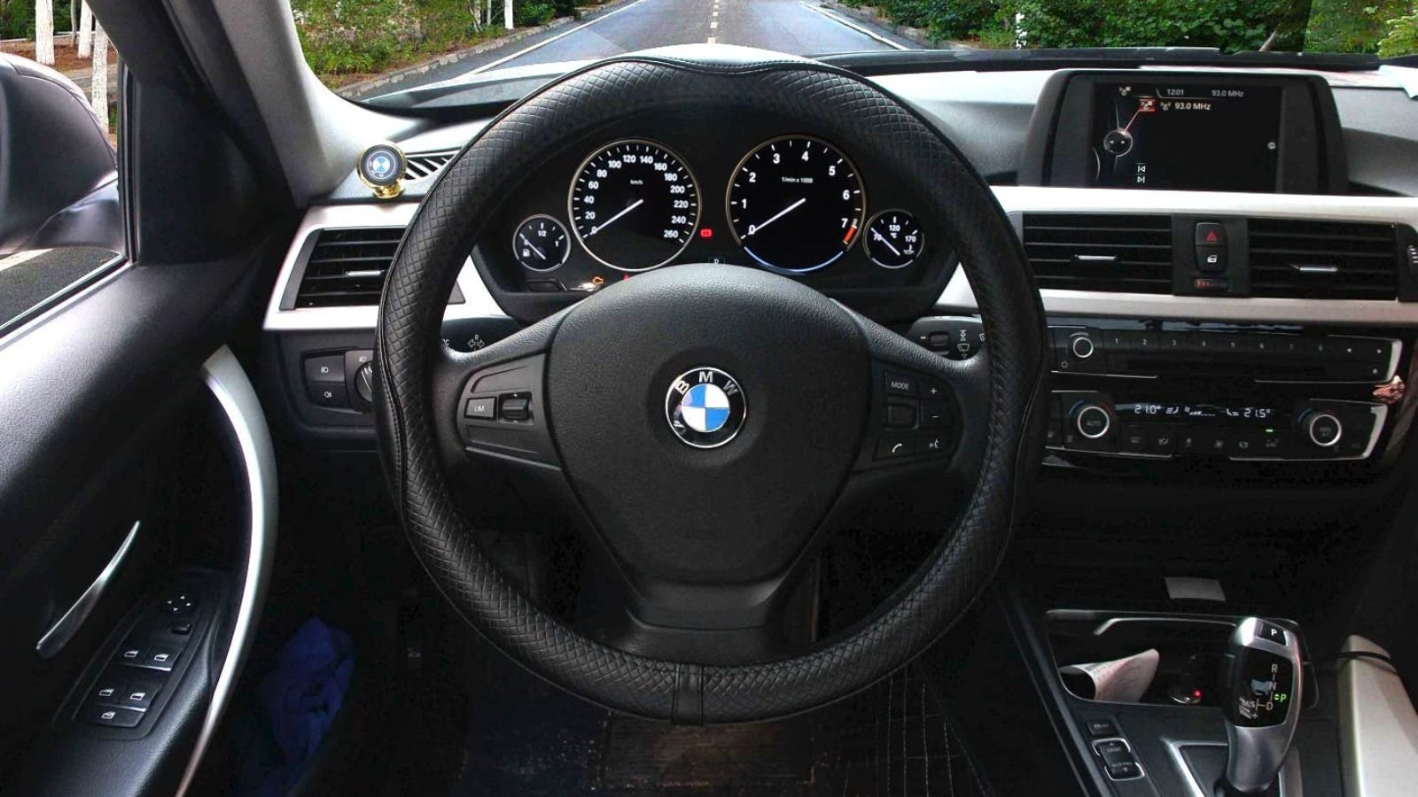 A steering wheel with a black leather cover.