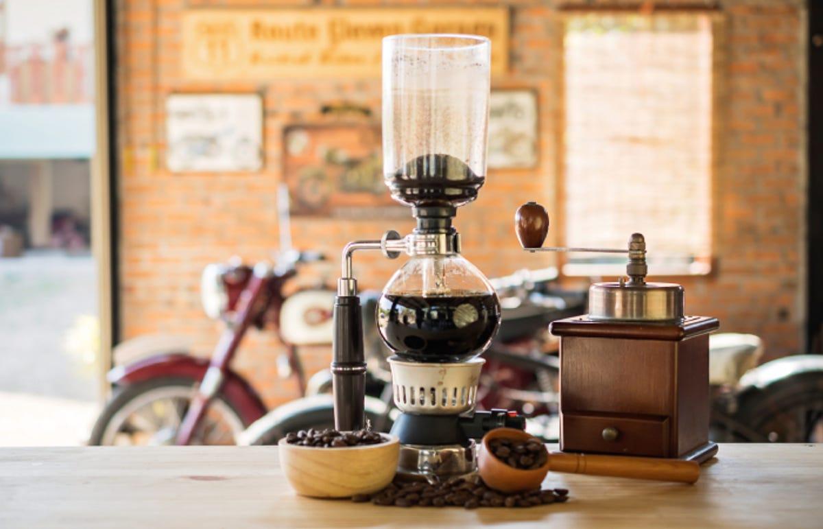 Siphon vacuum coffee maker on cafe bar