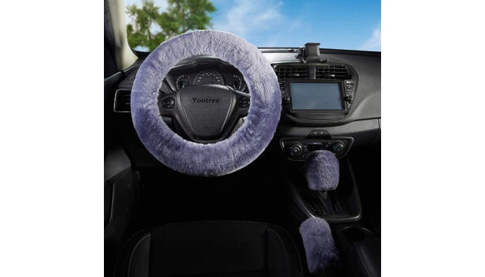 a purple fur cover on a car steering wheel