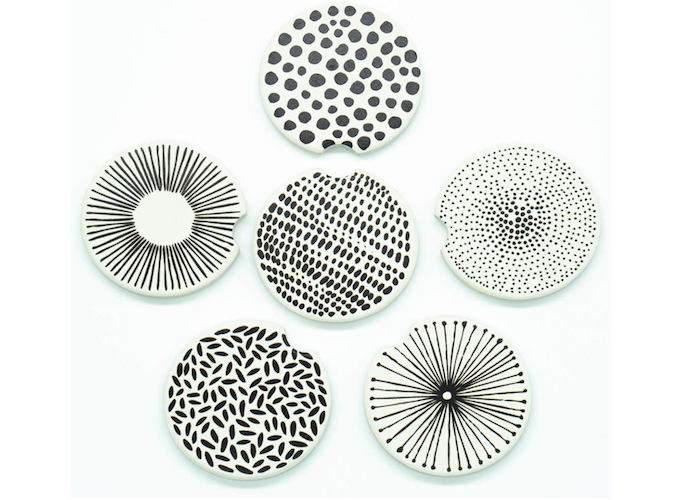 a set of six car cup holder coasters with varying black and white patterns
