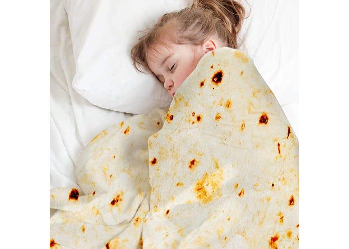 toddler girl asleep under burrito blanket