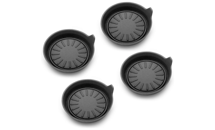 a set of four black silicone cup holder coasters for a car