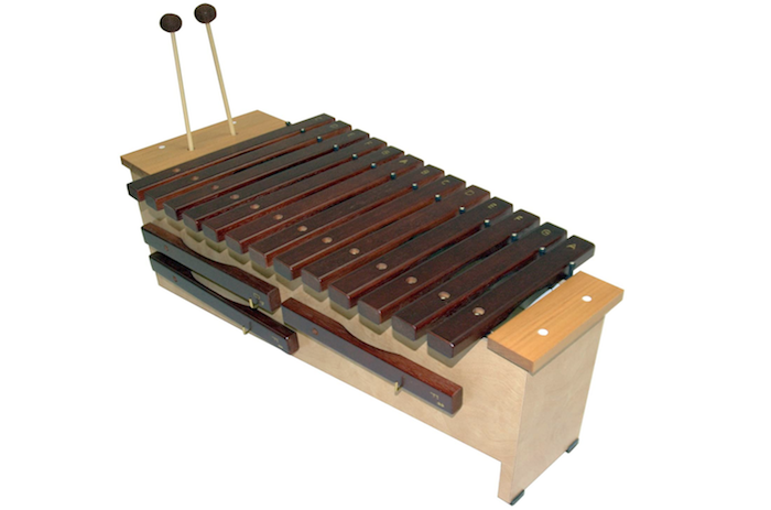 dark red-brown xylophone on a wooden stand with large, matching mallets