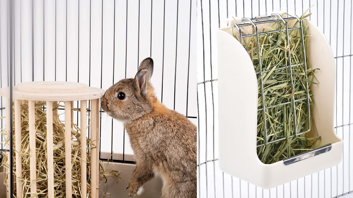 To the left, a rabbit in a cage eats out of a round hay feeder. To the right, a white hay feeder filled with green hay hangs off of a cage.